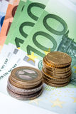 Euro banknotes and coins. Euro banknotes with various coins royalty free stock photography