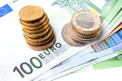 Euro banknotes and coins. Euro banknotes with various coins stock images