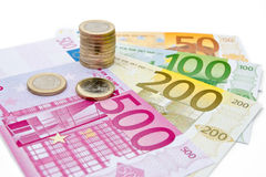 Euro banknotes and coins. On white background Stock Image