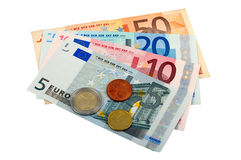 Euro Banknotes And Coins. Some euro coins lay on the european banknotes. Isolated on white background.  The file includes a clipping path Stock Images