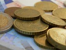 Euro banknotes and coins Royalty Free Stock Photos