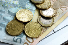Euro banknotes and coins. Placed over each other Royalty Free Stock Photography