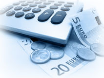 Euro banknotes and coins. Calculating Stock Photo