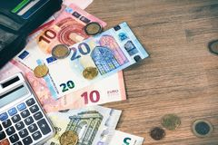 Euro banknotes and coins with bills to pay. Finances and budget. Concept with copyspace Royalty Free Stock Photo
