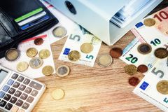 Euro banknotes and coins with bills to pay. Finances and budget. Concept, copyspace Stock Images