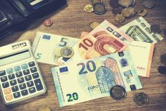 Euro banknotes and coins with bills to pay. Finances and budget. Concept Royalty Free Stock Photos