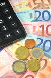 Euro banknotes, coins and calculator Royalty Free Stock Image