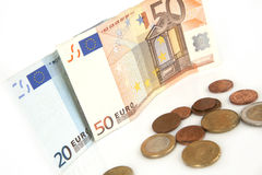 Euro banknotes and coins, cent, euro money on the white background Royalty Free Stock Photo