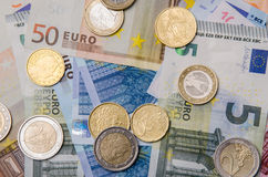 Euro banknotes and coins Royalty Free Stock Images