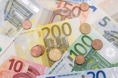 Euro banknotes with coins Stock Image