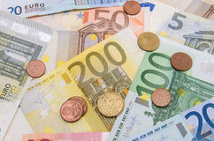 Euro banknotes with coins Stock Images