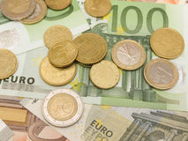 Euro banknotes and coins Stock Images
