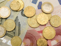 Euro banknotes and coins Royalty Free Stock Photos