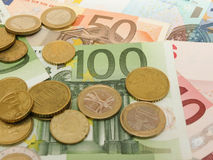 Euro banknotes and coins Royalty Free Stock Photography