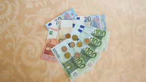 Euro banknotes and coins Stock Photography