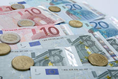 Euro banknotes with coins Royalty Free Stock Photography
