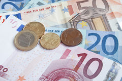 Euro banknotes and coins Stock Photos