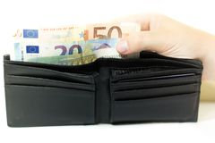 Euro banknotes and coins. Money in the wallet. Economy in Europe royalty free stock photography