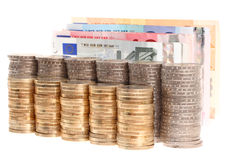Euro banknotes and coins organized in columns Stock Images