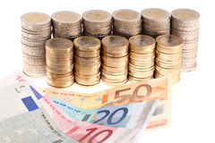 Euro banknotes and coins organized in columns Royalty Free Stock Image