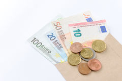 Euro banknotes and coins on white background Royalty Free Stock Image