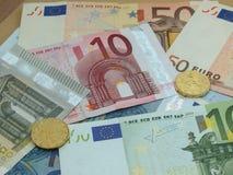 Euro banknotes and coins Stock Photos