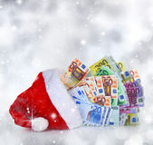 Euro banknotes. Coming out of Santa Claus hat Stock Image