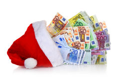 Euro banknotes. Coming out of Santa Claus hat on white background Stock Image