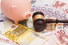 Euro banknotes with court gavel and piggy bank Royalty Free Stock Photography