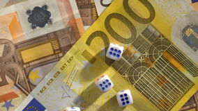 Euro Banknotes and dice stock video footage