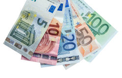 Euro banknotes with different denomination and coins. Isolated on white stock image