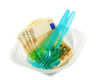 Euro banknotes on disposable tableware Stock Photography