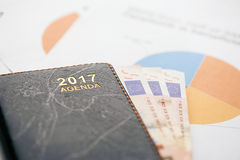 Euro banknotes and documents. 2017 agenda Royalty Free Stock Photo