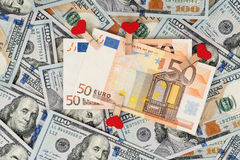 Euro banknotes on dollars Royalty Free Stock Photos