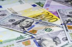 Euro banknotes and dollars randomly laid out royalty free stock photography