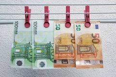 Euro banknotes drying. Washed Euro paper bills. Drying euro on a string. stock image