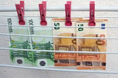 Euro banknotes drying. Washed Euro paper bills. Drying euro on a string. royalty free stock photos