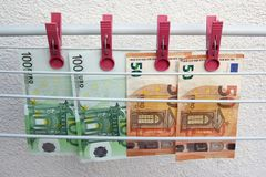 Euro banknotes drying. Washed Euro paper bills. Drying euro on a string. royalty free stock photo
