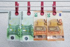 Euro banknotes drying. Washed Euro paper bills. Drying euro on a string. stock photography
