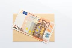 Euro banknotes on envelope. White background Stock Photo