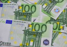 Euro banknotes 100 EUR. Group of 100 Euro bills banknotes money. European Union Currency Stock Photos