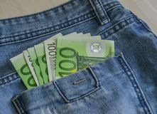Euro banknotes EUR on the pocket stock photography