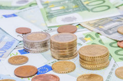 Euro banknotes and euro coins in simple example Stock Images