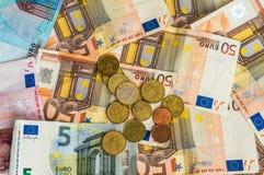Euro banknotes and euro coins Stock Photo