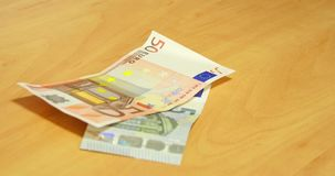 Euro Banknotes Fall On The Table. Close up stock video footage