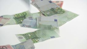 Euro banknotes fall on table stock video