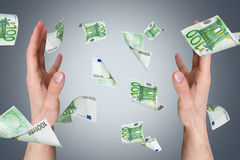 Euro Banknotes Falling on Young Male Hands Royalty Free Stock Photo