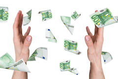 Euro Banknotes Falling on Young Male Hands Royalty Free Stock Photos