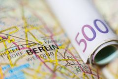 Euro banknotes on a geographical map of Berlin Stock Photos