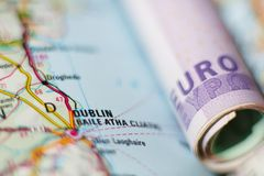 Euro banknotes on a geographical map of Dublin Stock Image